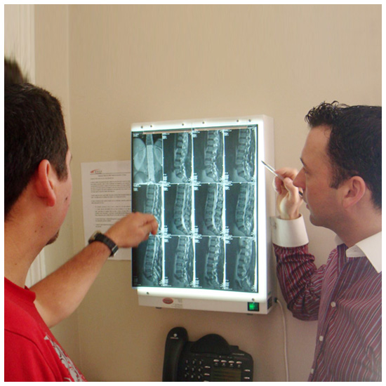 Looking at x-rays with patient