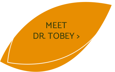 Dr. Tobey talking to patient