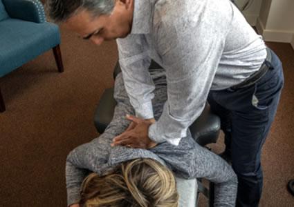 Dr. Tobey adjusting patients back