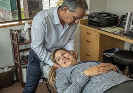 Dr. Tobey adjusting womans neck