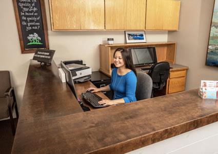 Receptionist at desk