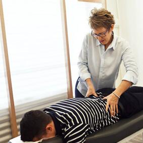 Dr O'Brien adjusting patient's lower back