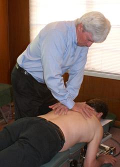 Hamilton Chiropractor, Dr Stephen Hehir (Chiropractor) adjusting a patient.