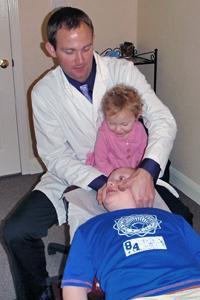Dr. Erik Weber of Weber Chirpractic and young patient