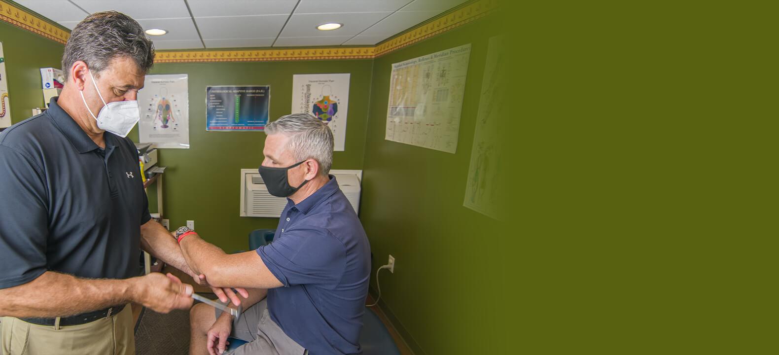 Dr. Mark examining patient