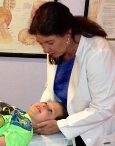 Dr. Janet adjusting Jeremiah.
