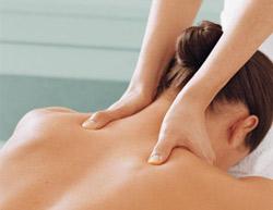 Massage Therapist massaging patient's neck