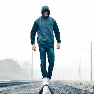 man walking in balance