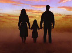 Family walking in sunset