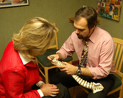 Dr. John reviewing spine with patient