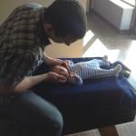 Doctor adjusting infant
