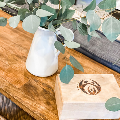 wooden box with logo and plant