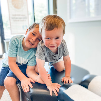 two little boys at chiropractic visit smiling