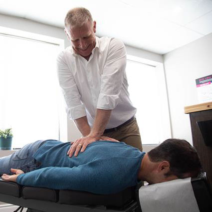 Dr Peter adjusting patient