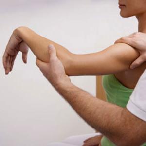 Chiropractor testing range of motion
