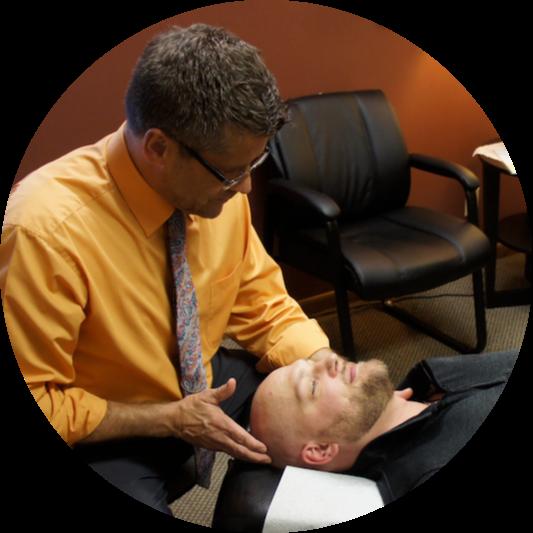 Faceup cervical adjustment by Dr. Burtis