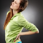 http://www.dreamstime.com/stock-photos-young-woman-having-severe-lumbar-pain-studio-shot-over-grey-background-image36693003