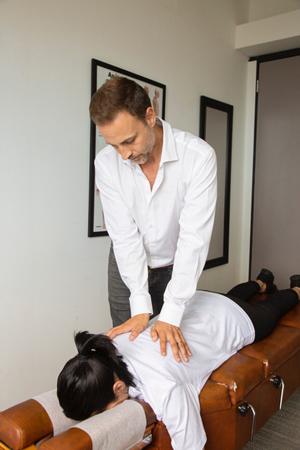 Dr. Delgado doing a treatment
