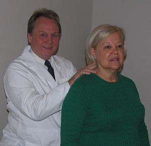 Dr. W. Gregory Capps adjusting neck