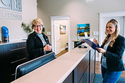 Woman filling out paperwork at reception desk