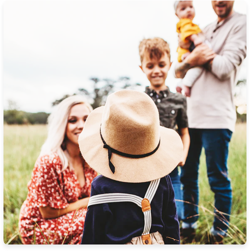 family standing in field
