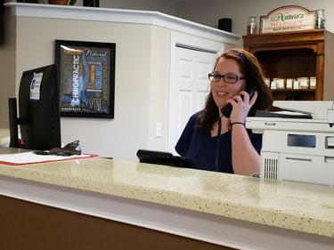 receptionist-on-phone