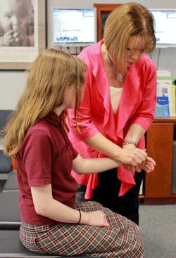 Chiropractor adjusts patients wrist