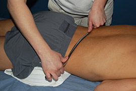 GT-1 Instrument pictured treating a patient's low back musculature