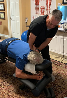 Photo of Dr. Cardwell adjusting a patient.