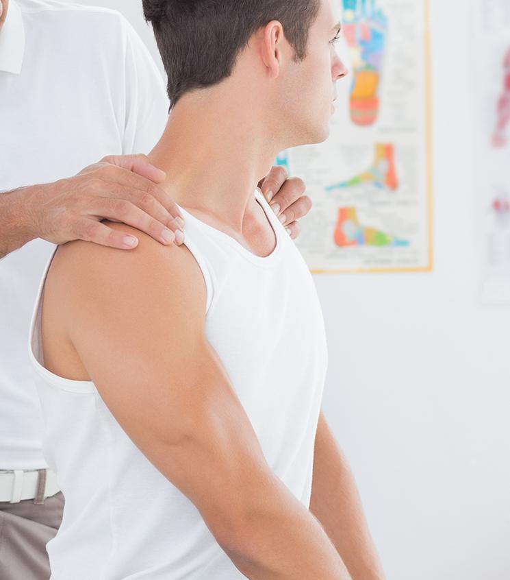 hands on patients shoulders