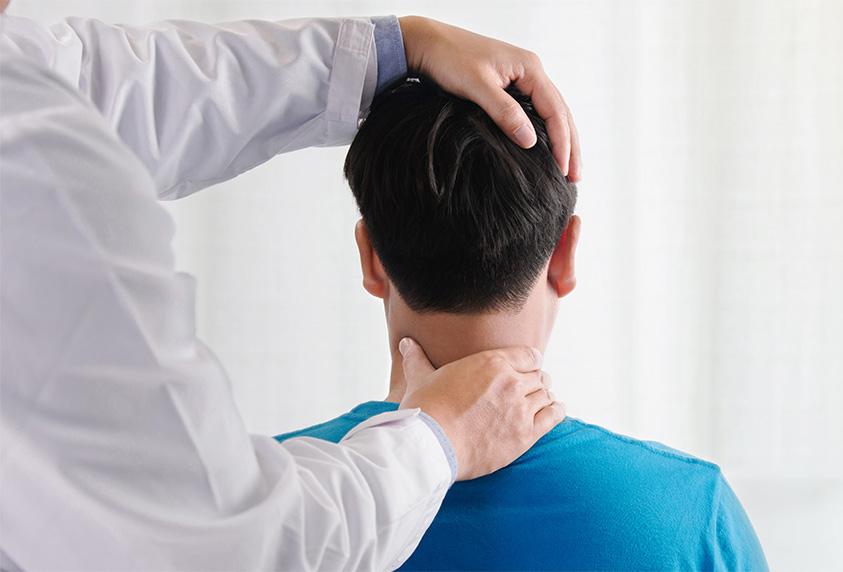 adjusting man's neck