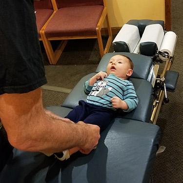 Dr. Nick adjusting baby