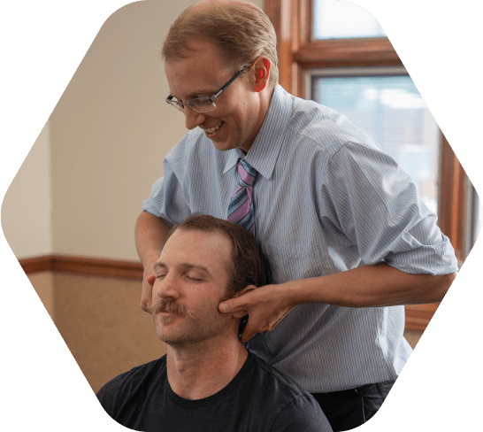Dr. Brandon adjusting patient
