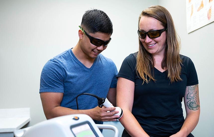 Patient getting laser on elbow