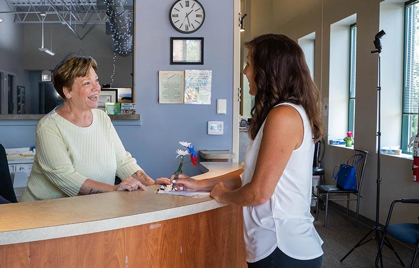 Staff welcoming new patient