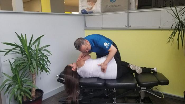 dr-wong-adjusting-pregnant-woman