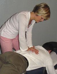Dr. Terri Lechner adjusting patient