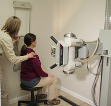Chiropractor conducting xrays
