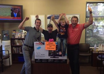 Brisbin Family Chiropractic chiropractors pose with the 2013 Patient Appreciation Day grand prize winner