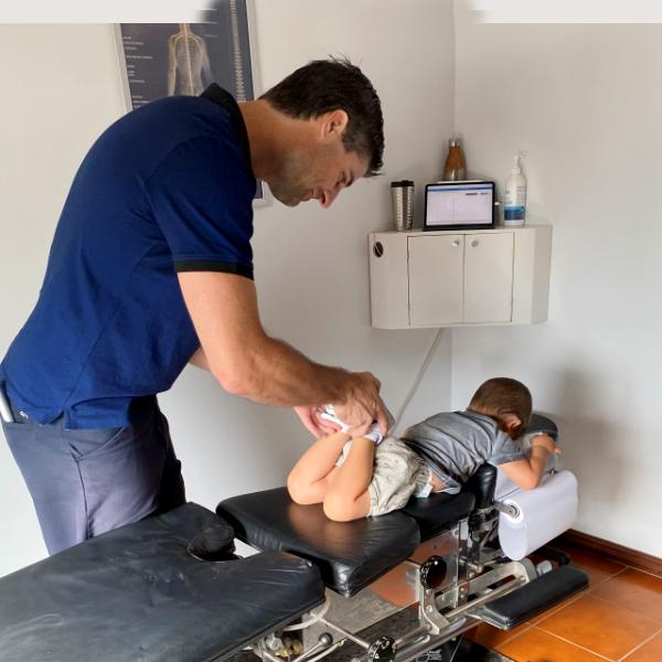 Dr. Clay adjusting young boy
