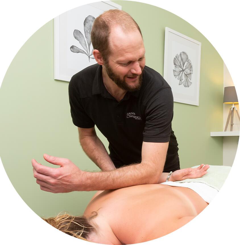 Dr. Sean adjusting womans back