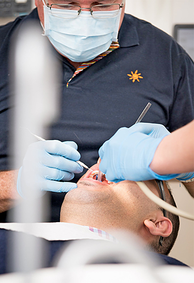 Your journey to dental health starts with a thorough examination.