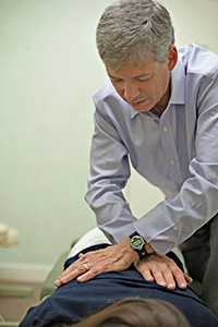 Dr. Terry adjusts a patient at Harvard Chiropractic