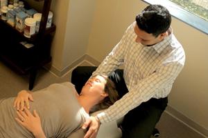 Dr. Dudum adjusting a patient