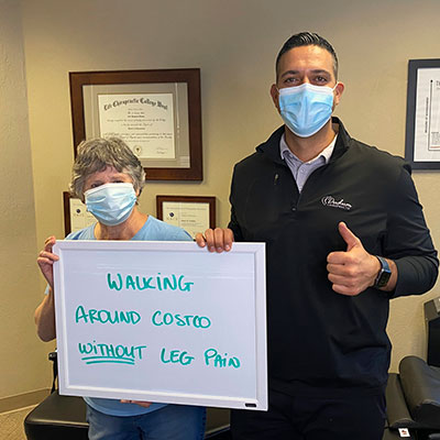 Doctor and patient holding sign