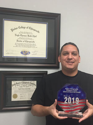 Dr. Eagle with awards
