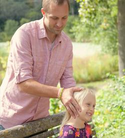 Asheville Chiropractor Dr. Derek Kasten adjusts his daughter