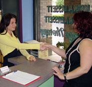 Receptionist greeting patient