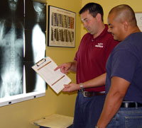 Dr Mark reviewing Report of Findings with patient