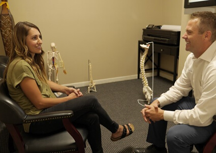 Dr. Alexander talking to patient